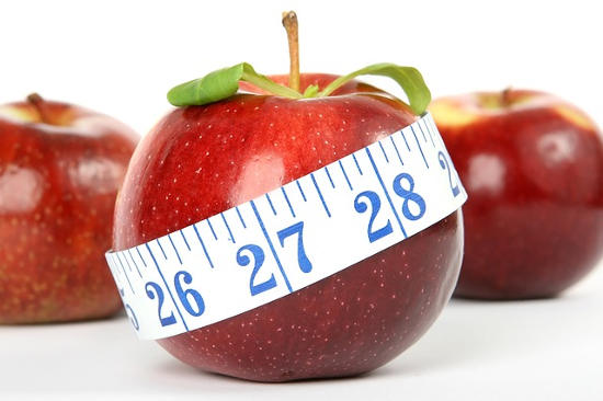 Apples with a tape measure around one apple