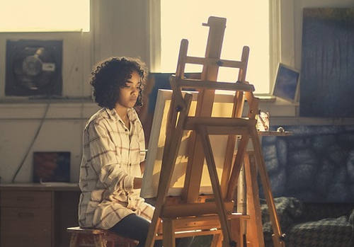 A lady painting a picture
