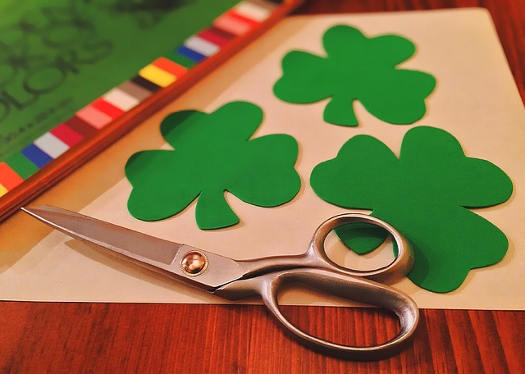 Cutting out Shamrock shapes for St Patrick's Day