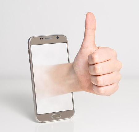 An android device with a hand and thumbs-up displayed